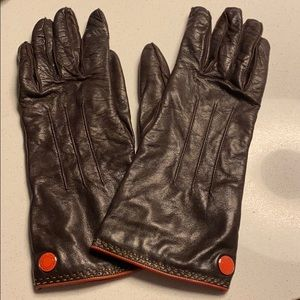 brown leather coach gloves with orange stitching
